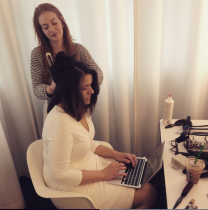 Here's a photo of me on my wedding day, updating social media even while getting my hair done.